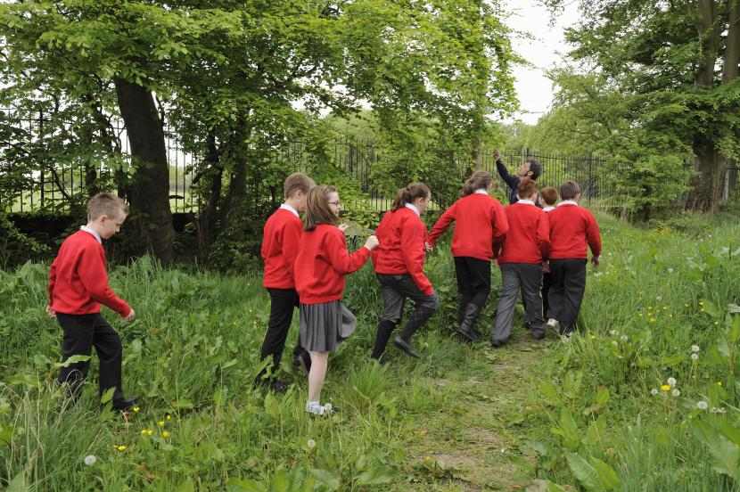 School children on a ranger led nature walk near Carmunnock cemetery, Glasgow as part of biodiversity week.
