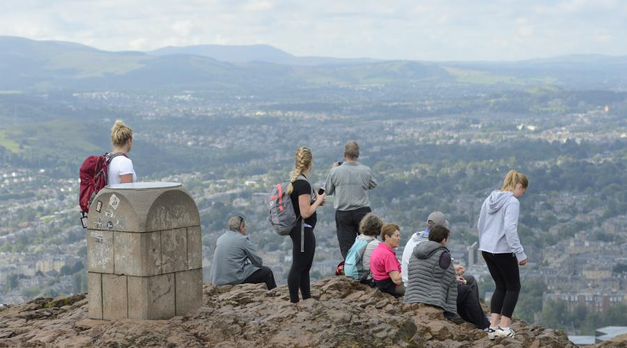 Tourists enjoying the view over Edinburgh from Arthur's Seat ©Lorne Gill/SNH. For information on reproduction rights contact the Scottish Natural Heritage Image Library on Tel. 01738 444177 or www.nature.scot