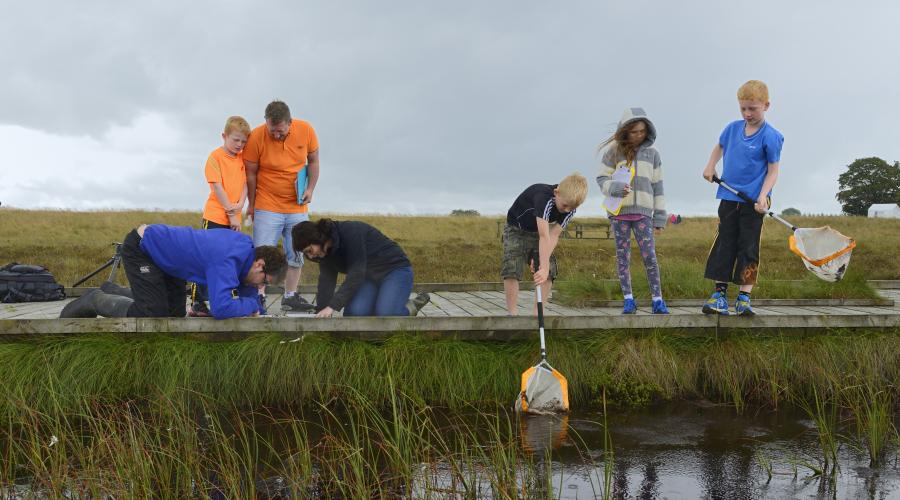 World bog day, Blawhorn Moss NNR. A family group pond dipping for invertebrates. ©Lorne Gill/SNH. For information on reproduction rights contact the Scottish Natural Heritage Image Library on Tel. 01738 444177 or www.nature.scot