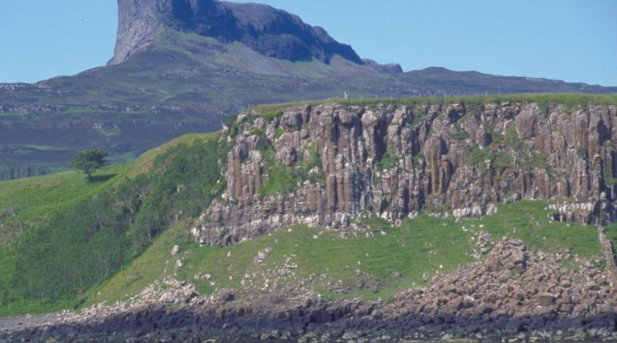 Basalt Cliffs and the Sgurr of Eigg, Lochaber. ©Lorne Gill/SNH. For information on reproduction rights contact the Scottish Natural Heritage Image Library on Tel. 01738 444177 or www.nature.scot
