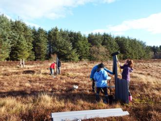 Group of volunteers ditch blocking. ©Butterfly Conservation Scotland