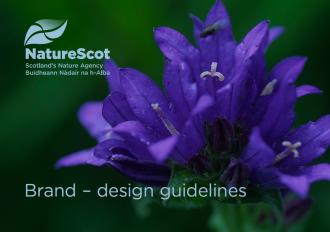 Deep purple flower with NatureScot's logo