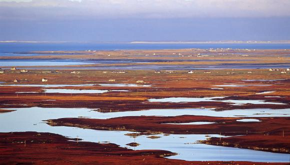 View north west across the peatland lochs and machair of South Uist and Benbecula ©Lorne Gill/SNH. For information on reproduction rights contact the Scottish Natural Heritage Image Library on Tel. 01738 444177 or www.nature.scot
