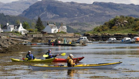 Tourists on a Sea Kayak taster day at Plockton, West Highland Area ©Lorne Gill/SNH. For information on reproduction rights contact the Scottish Natural Heritage Image Library on Tel. 01738 444177 or www.nature.scot