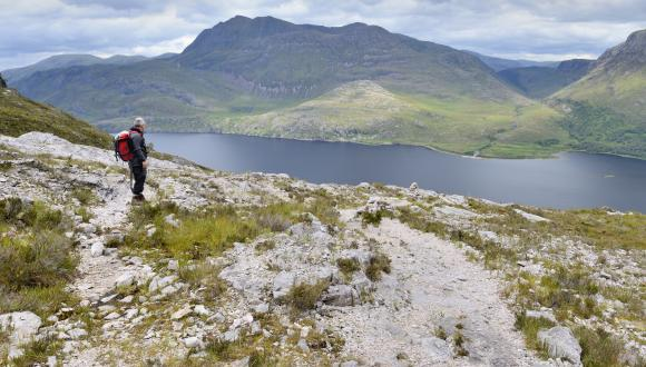 A hillwalker enjoying the view over Loch Maree from the ascent of the mountain trail at Beinn Eighe NNR, Wester Ross. ©Lorne Gill/SNH. For information on reproduction rights contact the Scottish Natural Heritage Image Library  on Tel. 01738 444177 or www.nature.scot