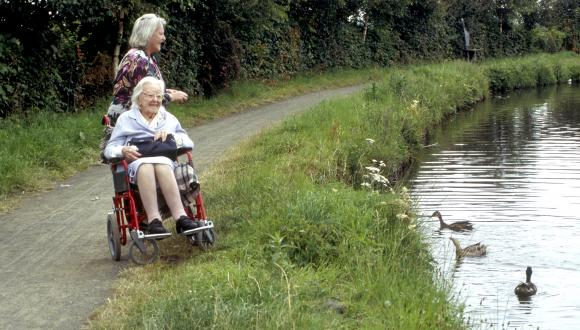 Women with wheelchair feeding ducks, Ratho.  ©GeorgeLogan/SNH. For information on reproduction rights contact the Scottish Natural Heritage Image Library on Tel. 01738 444177 or www.nature.scot
