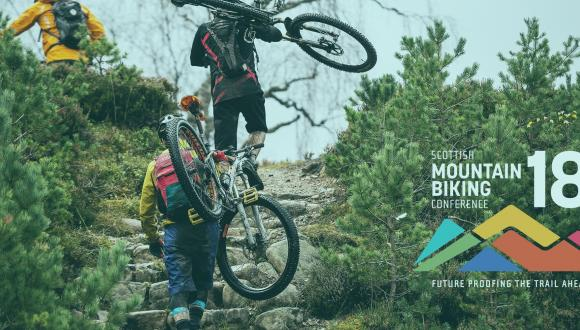 Scottish Mountain Bike Conference 2018 poster depicting mountain bikes being carried over shoulders up hill. ©Lorne Gill/SNH. For information on reproduction rights contact the Scottish Natural Heritage Image Library on Tel. 01738 444177 or www.nature.scot