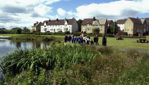 Pupils and teachers by the pond at Glenboig Village Park