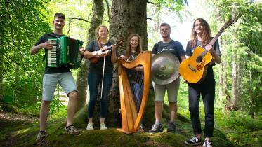 Ceilidh band playing in the forest