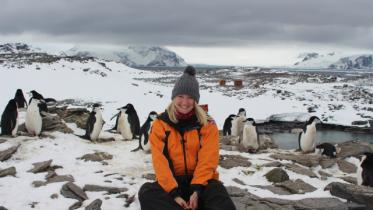 Lucy and penguins. Photo by Sian Tarrant